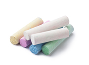 arious colors of chalks on white background.