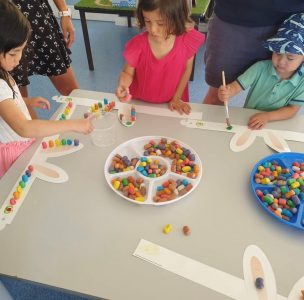 young children doing an Easter craft and activity and having lots of fun at playgroup